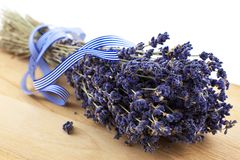 Dry lavender bunch on a wood board Stock Photo