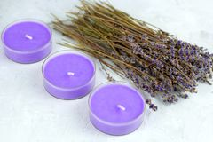 Lavender flowers and candles. Dry lavender flowers and candles stock photos