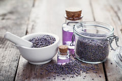 Dry lavender flowers in mortar,  jar of lavender and oil Stock Photo