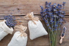 Dry lavender flowers and sachets. Top view. Royalty Free Stock Image