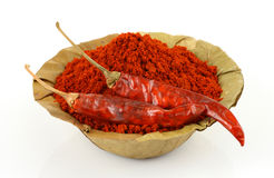 Dry leaf bowl of red chillies powder Stock Photography