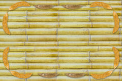 Dry leaf frame on bamboo background Stock Image