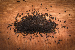 Dry leaves of black tea on the redwood table Stock Image
