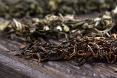 Dry leaves of different types of tea Stock Photos
