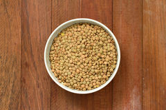 Dry lentil on bowl Stock Image