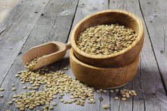 Dry lentils in a wooden bowl Royalty Free Stock Images