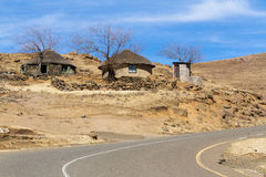 Dry Lesotho Winter. Traditional Basotho huts line the road on a sunny winter day in rural Leribe, Lesotho Stock Image