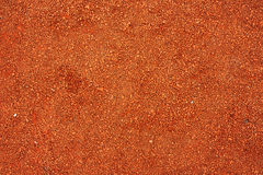 Dry light red crushed bricks surface. On outdoor running track or tennis court stock photos