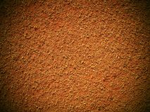 Dry light red crushed bricks surface on outdoor tennis ground. Detail of texture Royalty Free Stock Images