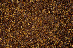 Dry loose Rooibos red tea, texture, background Royalty Free Stock Photography