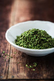 Dry lovage leaves in a bowl Stock Photography