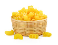 Dry macaroni in the basket royalty free stock photography