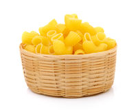 Dry macaroni in the basket stock photo