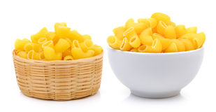 Dry macaroni in the white bowl and basket stock image