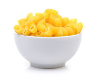 Dry macaroni in the white bowl on white background Royalty Free Stock Image