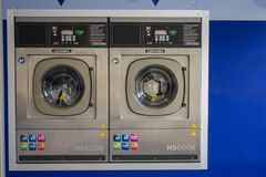 Dry machines in the self service laundry.  stock image