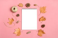 Dry maple leaves, macaroons and white notepad on pink millennial background Autumn concept To do list Mock up Top view Flat lay. Copy space stock photography