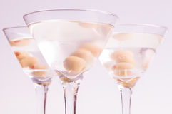 Dry Martini Cocktails over light purple background Royalty Free Stock Image