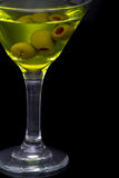 Dry martini and green olives in glass Royalty Free Stock Image