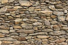 Dry masonry rock wall of natural stones Royalty Free Stock Images
