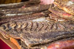Dry meat with salt and pepper on medieval market closeup. With copy space stock photography