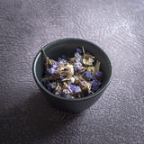 Dry medicinal herbs in bowl Royalty Free Stock Photo