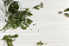 Dry Medicinal Herbs on the table stock photos