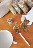 Dry medicinal herbs on a table Stock Photos