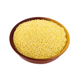 Dry millet in a bowl isolated on white. Spilled millet. Stock Image
