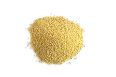 Dry millet isolated on white background. Photo heaps of millet cereals view from the top. Healthy diet. Vitamins in cereals. Dry millet isolated on white royalty free stock photos