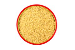 Dry millet isolated on white. Top view or flat lay. Healthy food and diet concept Stock Image