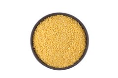 Dry millet isolated on white. Top view or flat lay. Healthy food and diet concept Royalty Free Stock Photography