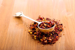 Dry mix of red herbal and fruit tea Royalty Free Stock Photo