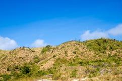 Dry mountain against blue sky Royalty Free Stock Photos