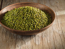Dry mung bean in ceramic bowl. On wooden table Stock Image