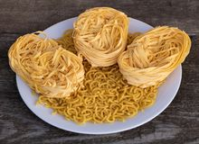 Dry noodles vs pasta in the plante. How to cook concept