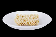 Dry noodles on the white disposable plate Stock Image