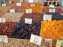 Dry nuts. And fruits on a market stall stock images