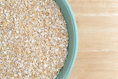 Dry oat bran hot cereal in a bowl Royalty Free Stock Photos