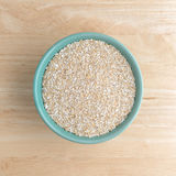 Dry oat bran hot cereal in a bowl Royalty Free Stock Images