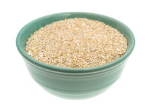 Dry oat bran hot cereal in a green bowl Stock Images