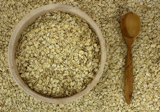 Dry oat flakes oatmeal in bowl on the background with wooden spo Royalty Free Stock Images