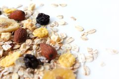 Dry oatmeal. Oatmeal with nuts, cornflakes and raisins. stock photos