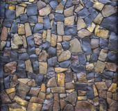 Dry old stone wall texture background close-up Stock Images