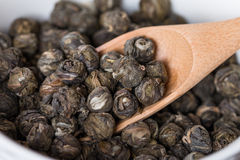 Dry oolong tea leaves in wooden spoons. Close up Stock Photography