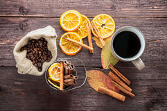 Dry orange and lemon, coffee beans in the bag, cinnamon and fallen autumn leaves Stock Image