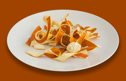 Dry Orange Peel. Zest Photographed with Natural Light Top View. Dry Orange Peel in White Plate. Zest Photographed with Natural Light Top View Stock Photo