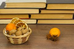Dry oranges in a basket on a wooden table royalty free stock photography
