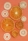 Dry oranges and white vintage elements of Irish crochet. Doilies, circle coasters, creative craft work. Food design stock photography