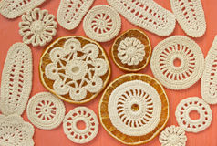 Dry oranges and white vintage elements of Irish crochet. Doilies, circle coasters, creative craft work. Food design stock photo